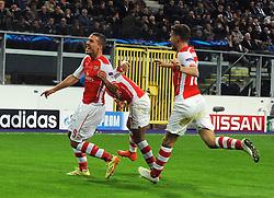 Arsenal's Lukas Podolski celebrates his goal with team mates - Photo mandatory by-line: Dougie Allward/JMP - Mobile: 07966 386802 - 22/10/2014 - SPORT - Football - Anderlecht - Constant Vanden Stockstadion - R.S.C. Anderlecht v Arsenal - UEFA Champions League - Group D