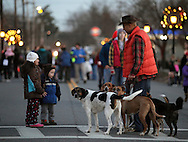 Pine Bush, New York  - Two children look at a group of dogs a man was walking during A Community Country Christmas 2011 on main street, which was closed to traffic, on  Dec. 3, 2011.