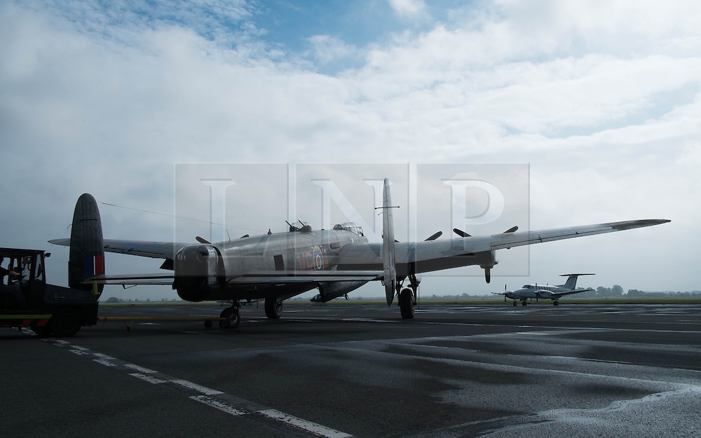 © Licensed to London News Pictures. <br /> 28/08/2014. <br /> <br /> Durham Tees Valley Airport, United Kingdom<br /> <br /> One of only two remaining flying Avro Lancaster bombers visits Durham Tees Valley airport today. <br /> <br /> The aircraft, 'Mynarski' is named after Pilot Officer Andrew Mynarski who flew with the Canadian Royal Air Force from the airport which was then called RAF Middleton St George.<br /> <br /> Pilot Officer Mynarski was posthumously awarded a VC after giving his life while trying to save a colleague when their Lancaster was shot down in June 1944.<br /> <br /> The famous World War Two aircraft is owned by the Canadian Warplane Heritage Museum and is beginning a 2-week tour of the UK.<br /> <br /> Photo credit : Ian Forsyth/LNP
