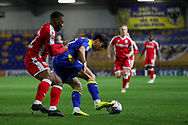 AFC Wimbledon midfielder Jack Rudoni (12) dribbling and battles for possession during the EFL Sky Bet League 1 match between AFC Wimbledon and Gillingham at Plough Lane, London, United Kingdom on 23 February 2021.