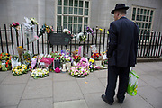 London, UK. Tuesday 7th July 2015. 10th anniversary of the London 7/7 bombings. Flowers are laid in memory of the victims of the terrorist attack in London. Here the memorial on Tavistock Square, where the bus bombing took place. Passers by gather to read the cards in memorial, and others to lay flowers. The 7 July 2005 London bombings (often referred to as 7/7) were a series of coordinated suicide bomb attacks in central London, which targeted civilians using the public transport system during the morning rush hour.