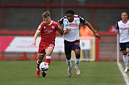 Crawley Town Midfielder Jake Hessenthaler (39)  and Bolton Wanderers Forward Oladapo Afolayan (30)  battles for possession during the EFL Sky Bet League 2 match between Crawley Town and Bolton Wanderers at The People's Pension Stadium, Crawley, England on 8 May 2021.