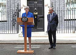Prime Minister Theresa May, accompanied by her husband Philip, making a statement in Downing Street after she traveled to Buckingham Palace for an audience with Queen Elizabeth II following the General Election results.