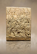 Photo of Hittite sculpted orthostats panels of Long Wall Limestone, Karkamıs, (Kargamıs), Carchemish (Karkemish), 900-700 B.C. Soldiers. Anatolian Civilisations Museum, Ankara, Turkey<br /> <br /> Figure of two helmeted warriors. They have their shield in their back and their spear in their hand. The prisoner in their front is depicted as small. The lower part of the orthostat is decorated with braiding motifs. <br /> <br /> On a brown art background. .<br />  <br /> If you prefer to buy from our ALAMY STOCK LIBRARY page at https://www.alamy.com/portfolio/paul-williams-funkystock/hittite-art-antiquities.html  - Type  Karkamıs in LOWER SEARCH WITHIN GALLERY box. Refine search by adding background colour, place, museum etc.<br /> <br /> Visit our HITTITE PHOTO COLLECTIONS for more photos to download or buy as wall art prints https://funkystock.photoshelter.com/gallery-collection/The-Hittites-Art-Artefacts-Antiquities-Historic-Sites-Pictures-Images-of/C0000NUBSMhSc3Oo