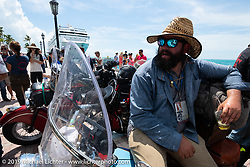 Evan Riggle with his 1942 Indian 4-cylinder after the Cross Country Chase motorcycle endurance run from Sault Sainte Marie, MI to Key West, FL. (for vintage bikes from 1930-1948). The Grand Finish in Key West's Mallory Square after the 110 mile Stage-10 ride from Miami to Key West, FL and after covering 2,368 miles of the Cross Country Chase. Sunday, September 15, 2019. Photography ©2019 Michael Lichter.