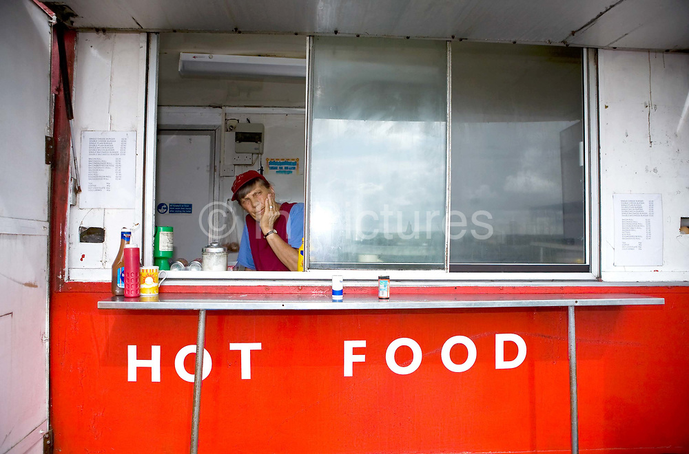 A female cook waits for customers at an isolated burger van which overlooks the Cornish Bodmin Moors along the A30 on the 23rd June 2008 in Bodmin Moor n the United Kingdom.