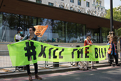 London, UK. 29th May, 2021. Activists hold a Kill The Bill banner outside New Scotland Yard during a Kill The Bill National Day of Action in protest against the Police, Crime, Sentencing and Courts (PCSC) Bill 2021. The PCSC Bill would grant the police a range of new discretionary powers to shut down protests, including the ability to impose conditions on any protest deemed to be disruptive to the local community, wider stop and search powers and sentences of up to 10 years in prison for damaging memorials.