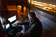 Det. James Rosse inspects his rooftop infrared camera gear during the Salt Lake Police Department sting operation designed to apprehend car prowlers in downtown Salt Lake City , Monday, Nov. 19, 2012.