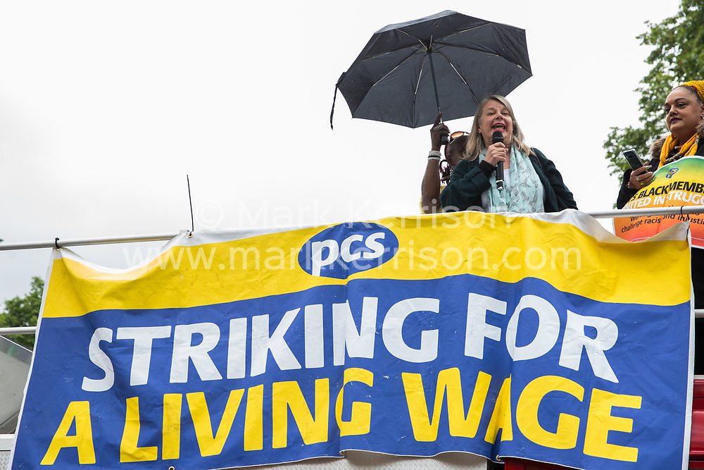 London, UK. 19 June, 2019. Marion Lloyd, President of BEIS PCS, addresses outsourced catering, security, postal, porter and cleaning staff belonging to the Public & Commercial Services Union (PCS) and working at the Department for Business, Energy and Industrial Strategy (BEIS) via contractors ISS World and Aramark at a rally outside Parliament on the third day of continuing industrial action for the London Living Wage, terms and conditions comparable to the civil servants they work alongside and an end to outsourcing.