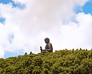 The Tian Tan or Giant (big) Buddha is seen here resting on top of the mountain at Ngong Ping, Lantau Island in Hong Kong. This giant statue appears to float above the forest in a permanent state of meditation.<br /> <br /> Available to download for personal and commercial use or to purchase as a canvas print, photo print and framed photo print.