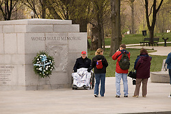 Washington DC, The National World War II Memorial, showing Pacific and European Theatres, with 4000 stars one each for 100 men who died, hosting veterans returning for a final look.  Photo wash99315-70636..Photo copyright Lee Foster, www.fostertravel.com, lee@fostertravel.com, 510-549-2202..