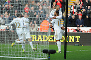 Swansea city's Luke Moore © celebrates with Wayne Routledge after he  scores the first goal to make it 1-0.  Barclays premier league, Swansea city v Newcastle Utd at  the Liberty stadium in Swansea, South Wales on Saturday 2nd March 2013. pic by  Andrew Orchard, Andrew Orchard sports photography,