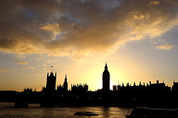 Sunset over the Houses of Parliament and the river Thames in London, UK. Thursday, 14th November 2013. Picture by Ben Stevens / i-Images