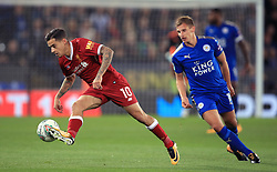 Liverpool's Philippe Coutinho (left) and Leicester City's Marc Albrighton battle for the ball during the Carabao Cup, third round match at the King Power Stadium, Leicester.