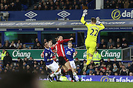 Zlatan Ibrahimovic of Manchester United chips the ball over Everton Goalkeeper Maarten Stekelenburg to score his teams 1st goal. . Premier league match, Everton v Manchester United at Goodison Park in Liverpool, Merseyside on Sunday 4th December 2016.<br /> pic by Chris Stading, Andrew Orchard sports photography.