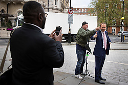 © Licensed to London News Pictures. 11/05/2021. London, UK. Secretary of State for Health and Social Care Matt Hancock gives a thumbs up as he prepares to speak to the media outside the BBC. Photo credit: George Cracknell Wright/LNP