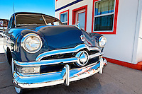 WILLIAMS, AZ - JUNE 17: Old Ford car parked outside a station  in Williams Arizona, taken June 17, 2010. Williams is a popular tourist destination. Image available to license as EDITORIAL USE ONLY.