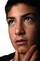 Portrait of teenage boy looking thoughtful,