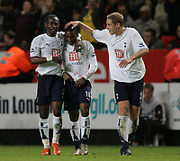 Photo: Lee Earle.<br /> Charlton Athletic v Tottenham Hotspur. The Barclays Premiership. 07/05/2007.Tottenham's Didier Zokora (L) and Michael Dawson (R) congratulate Jermaine Defoe after he scored their second.