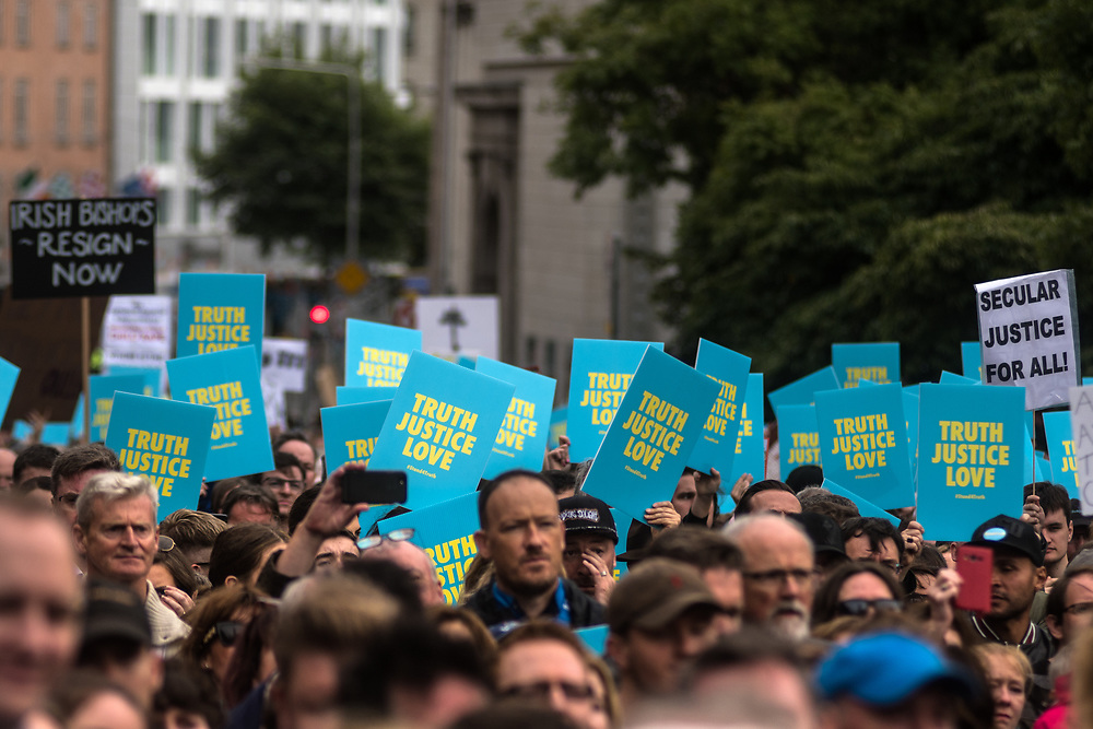 """Dublin, Ireland. 26th August, 2018. <br /> Survivors and citizen gather together to protest during the Holy Mass, at the Stand4Truth protest in Garden of Remembrance, Parnell square, during the second of the two-days of the visit of Pope Francis in Dublin, Ireland.<br /> Pope Francis has made a two-day visit to the Republic of Ireland by celebrating a Mass at Dublin's Phoenix Park. The Argentine Pope asked forgiveness for the """"abuses in Ireland, abuses of power, conscience and sexual abuses"""" perpetrated by Church leaders. It was the first papal visit to Ireland for 39 years. During his activities many activists, victims and survivors have made protests and a silent march Garden of Remembrance towards the last Magdalene Laundry to close in Ireland.<br />  © Simone Padovani"""