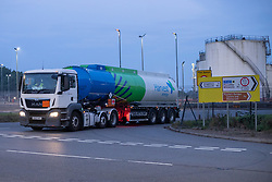 © Licensed to London News Pictures. 26/09/2021. Kingsbury, Warwickshire, UK. The scene as dawn breaks on a Sunday morning outside Kingsbury fuel depot, the main fuel distribution site in the Midlands. Pictured a Harvest fuel tanker leaves the Kingsbury site. Photo credit: Dave Warren / LNP