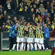 Fenerbahce's Mehmet Topuz (C) celebrate his goal with team mate during their Turkish superleague soccer derby match Fenerbahce between Trabzonspor at the Sukru Saracaoglu stadium in Istanbul Turkey on Sunday 18 December 2011. Photo by TURKPIX