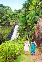 woman tourists visiting Kulaniapia Falls, tropical rainforest jungle, Hilo, Big Island, Hawaii, USA, Model Released - MR#: 000102, 000103