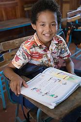 Central America, Nicaragua, Granada.  Boy in classroom at school in Santa Ana de Malacos.  MR