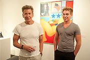 CALVIN KLEIN; NICHOLAS GRUBER, Opening of Art Basel Miami Beach. Convention Centre.  Miami Beach. 30 November 2010. -DO NOT ARCHIVE-© Copyright Photograph by Dafydd Jones. 248 Clapham Rd. London SW9 0PZ. Tel 0207 820 0771. www.dafjones.com.