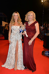 Left to right, AMANDA HOLDEN and CLAIRE HORTON Chief Executive of Battersea Dogs & Cats Home with her dog Wilma at Battersea Dogs & Cats Home's Collars & Coats Gala Ball held at Battersea Evolution, Battersea Park, London on30th October 2014.