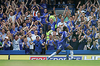 Photo: Lee Earle.<br /> Chelsea v Liverpool. The Barclays Premiership. 17/09/2006. Chelsea's Didier Drogba celebrates his goal in front of the fans.