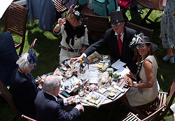 Racegoers enjoy lunch in the royal enclosure during day four of Royal Ascot at Ascot Racecourse.