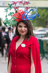 Ascot, UK. 20 June, 2019. A racegoer wearing a hat in the colours of the flag of Azerbaijan attends Ladies Day at Royal Ascot.