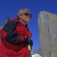 Rick Ridgeway stands under Rakekniven spire, Queen Maud Land, Antarctica.