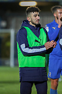 AFC Wimbledon Husuyin Biler (32) clapping whilst walking off the pitch during the EFL Sky Bet League 1 match between AFC Wimbledon and Doncaster Rovers at the Cherry Red Records Stadium, Kingston, England on 14 December 2019.