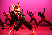 Youngsters from the East London Dance Youth Company on stage dancing at the Stratford Circus Theatre, London.