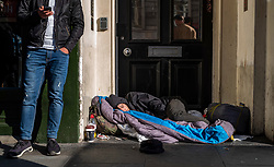 FILE IMAGE © Licensed to London News Pictures. 22/10/2019. London, UK. A homeless man sleeps in a doorway in Whitehall, yards from Trafalgar Square. Pictures highlight the reality of homelessness in Westminster taken during the build up of Brexit and the General election just a few hundreds yards from Parliament and Downing Street. Photo credit: Alex Lentati/LNP