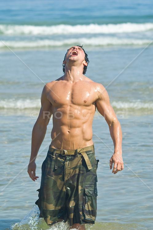 Very Good looking fit man in the Atlantic Ocean In Montauk, NY enjoying the sun