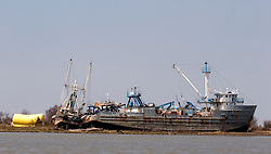26 Sept, 2005.  Lake Calcasieu.  Hurricane Rita aftermath. <br /> <br />  Ships lifted from the water rest on the shoreline.<br /> Photo; ©Charlie Varley/varleypix.com