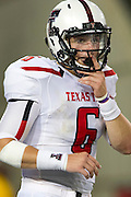 DALLAS, TX - AUGUST 30: Baker Mayfield #6 of the Texas Tech Red Raiders reads the defense against the SMU Mustangs on August 30, 2013 at Gerald J. Ford Stadium in Dallas, Texas.  (Photo by Cooper Neill/Getty Images) *** Local Caption *** Baker Mayfield