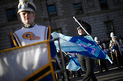 """© London News Pictures. 01/01/2013. London, UK.  The Germantown High School """"Warhawk"""" marching band from the USA take part in the 2012 New Years Parade through the centre London on January 1st, 2013. Photo credit : Ben Cawthra/LNP"""