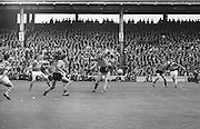 Kerry tries to prevent Down from making a kick during the All Ireland Senior Gaelic Football Final Kerry v Down in Croke Park on the 22nd September 1968. Down 2-12 Kerry 1-13.
