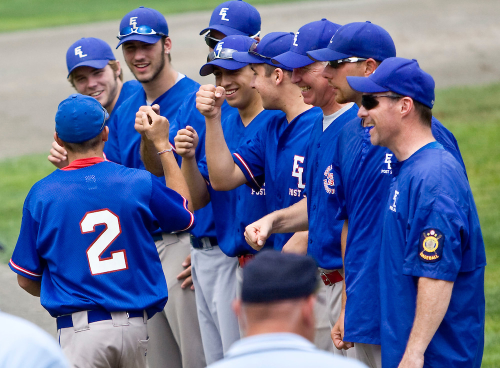 MIDDLETOWN, CT - 05 AUGUST 2010 -.East Longmeadow Post 293's #2 (name not on roster) greets teammates as the team lines up on the baseball diamond on Palmer Field at the start of Thursday's American Legion Northeast Regional Tournament game in Middletown..Photo by Josalee Thrift