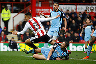 Brentford defender Nico Yennaris (8) scores a goal (score 2-1) during the EFL Sky Bet Championship match between Brentford and Rotherham United at Griffin Park, London, England on 25 February 2017. Photo by Andy Walter.