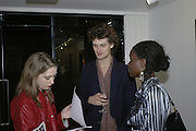 Daisy de Villeneuve, David Birkin and Nana Ayim, Vanishing Point 06. Photography exhibition private view at Madder Rose. Whitecross St. London. EC1. 25 October 2006. -DO NOT ARCHIVE-© Copyright Photograph by Dafydd Jones 66 Stockwell Park Rd. London SW9 0DA Tel 020 7733 0108 www.dafjones.com