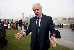 © licensed to London News Pictures. London, UK 28/02/2012. Mayor of London, Boris Johnson is giving an interview to a news channel about London's preparations for Olympics, this morning outside City Hall. Photo credit: Tolga Akmen/LNP