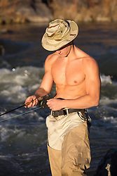 shirtless sexy fly fisherman outdoors in the Rio Grande River