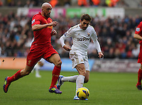 Sunday, 25 November 2012..Pictured: Angel Rangel of Swansea (R) challenged by Jose Enrique of Liverpool (L)..Re: Barclays Premier League, Swansea City FC v Liverpool at the Liberty Stadium, south Wales.