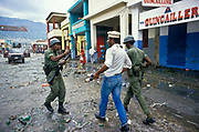 "In the immediate aftermath of the flight into French exile of the Haitian president ""Baby Doc"" Duvalier, residents in the city of Port-au-Prince go on city wide rampage and looting. The army attempt to intervene with little success such was the hate for the regime. Haiti."