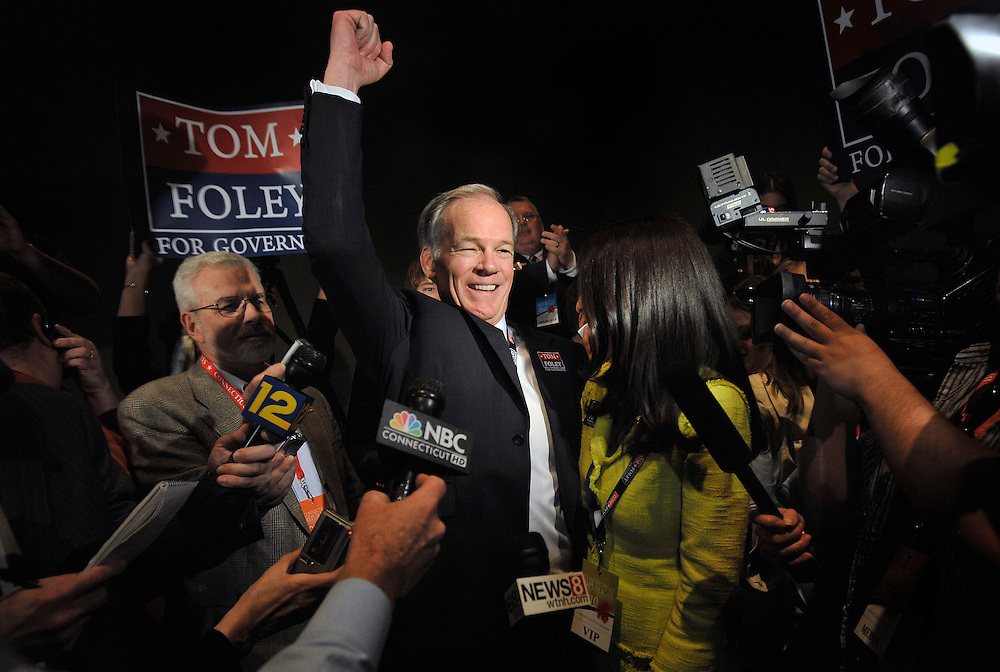 Republican candidate for Governor Tom Foley, center, and wife Leslie Fahrenkopf react after Foley received the nomination at the Connecticut Republican Convention in Hartford, Conn.(AP Photo/Jessica Hill)